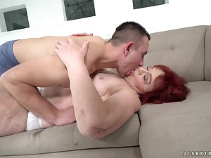 Redhead granny Marsha enjoys getting fucked by a handsome young guy