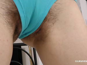 Nasty babe Mara Gri penetrates her hairy pussy with a dildo