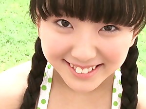 Cute Japanese teen with pigtails